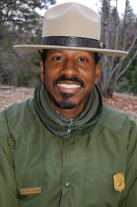 photo of an African American man in a park ranger hat