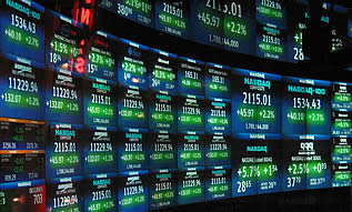 photo of a stock ticker wall