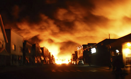 photo of a smalltown mainstreet engulfed in flames
