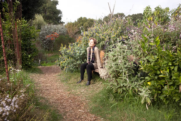 photo of a woman in a garden